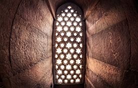 foto of qutub minar  - Window with sunglow in Qutub Minar complex in Delhi India - JPG