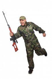 stock photo of handgun  - Running soldier with a handgun isolated on white - JPG