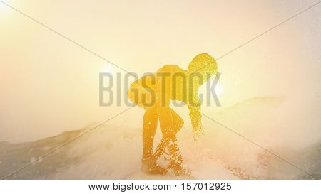 Silhouette of surfer perfoming in Australia with back light at sunset - Young man riding the wave in pacific ocean - Extreme sport concept - Focus on his face - Warm filter with sun flare