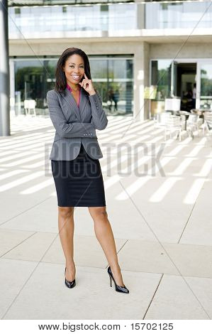 Attractive young business professional outside her office
