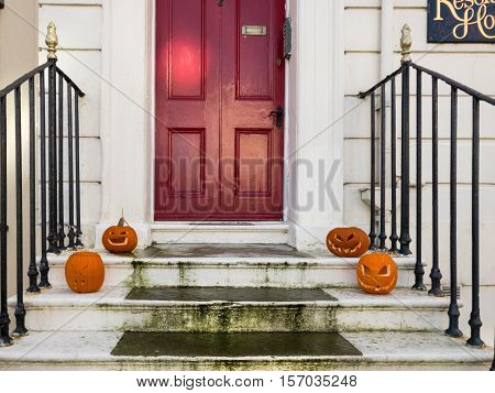 WHITBY ENGLAND - NOVEMBER 5: Halloween pumpkins on steps of a house in Whitby during Goth Festival weekend. In Whitby North Yorkshire England. On 5th November 2016.