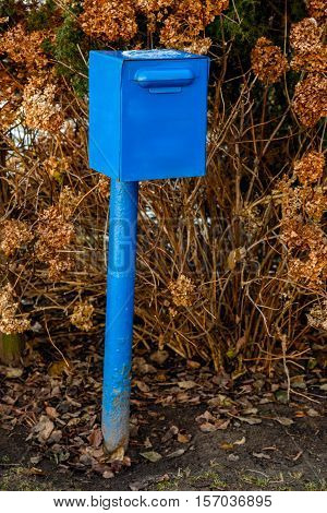 Blue mailbox on the outskirts of the village