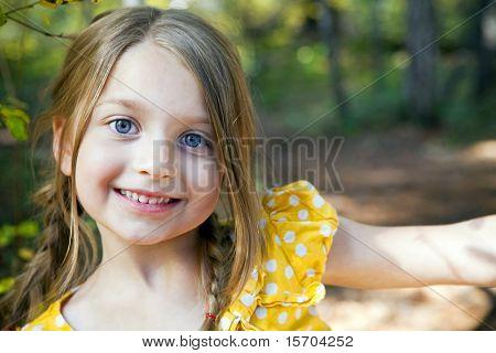 Portrait of a cute little girl outside
