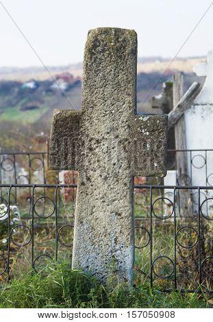 Old stone cross in cemetery ( gray stone cross )