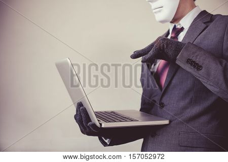 Business Man In White Mask Wearing Gloves And Using Computer - Fraud, Hacker, Theft, Cyber Crime Con
