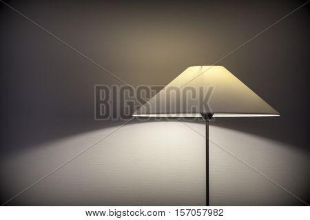Elegant lamp shade light falling off on hotel room wall