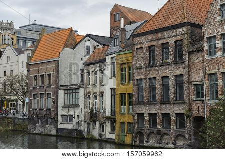 Old medieval buildings by canal in Gent