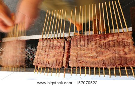 Meat Skewers Of Lamb Cooked On The Grill During The Village Feas