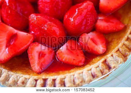 Glazed fresh strawberries over a custard pie