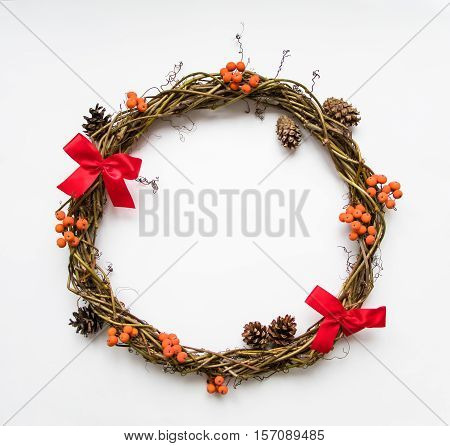 Christmas Wreath Of Vines With Bows, Rowanberries And Cones. Flat Lay, Top View