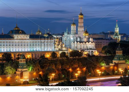 Kremlin wall, Ivan Great bell tower and Grand Kremlin Palace at evening in Moscow, Russia