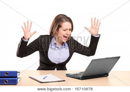 A nervous young businesswoman yelling isolated on white background