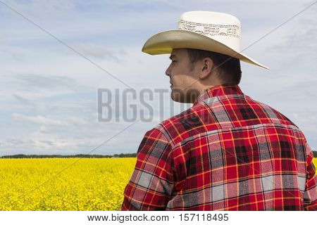 side view of a man wearing a cowboy hat