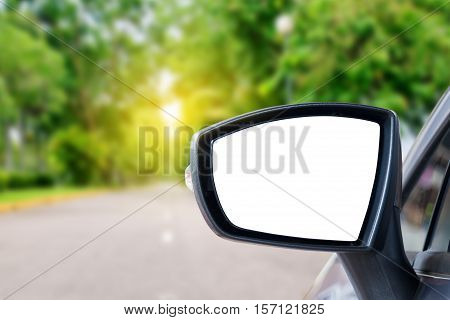 side rear-view mirror on a car in nature