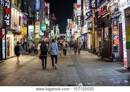 Busan South Korea - 11 May 2011: Image of a typical street at night in South Korea with shopping and bars