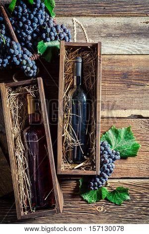Fresh Wine In Bottle In Wooden Box