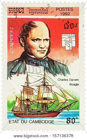 MOSCOW RUSSIA - NOVEMBER 12 2016: A stamp printed in Cambodia shows English scientist Charles Darwin and ship
