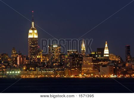 Mid-Town Manhattan Skyline At Night