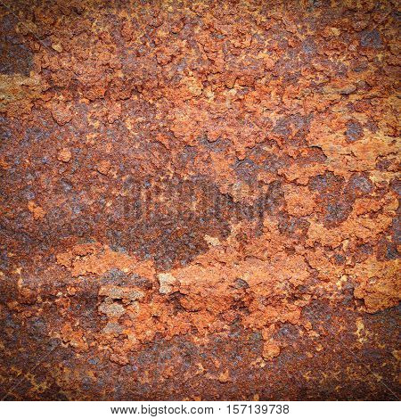 Rusty metal texture or rusty metal background. Rusty metal is caused by moisture in the air. Grunge retro vintage of rusty metal plate. Abstract rusty metal for design with copy space.
