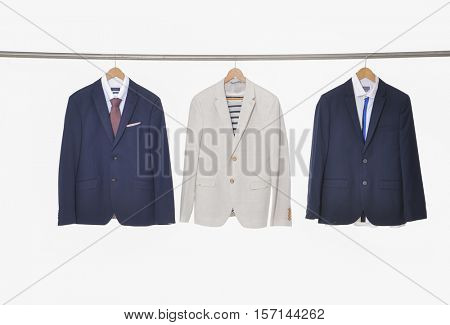 business man suit three clothes hanging