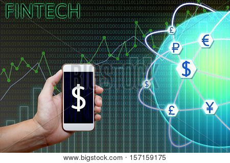 Financial technology (Fintech) concept. Man holding smartphone and charts graph analyzing with currency global network and binary background.