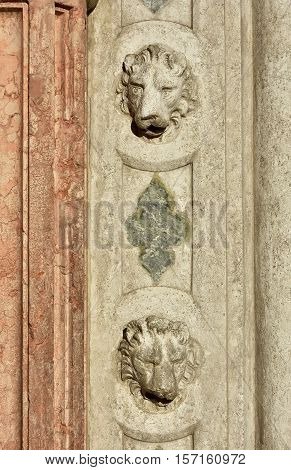 Two Venice Lion heads from old gothic portal in Saint Mark Square
