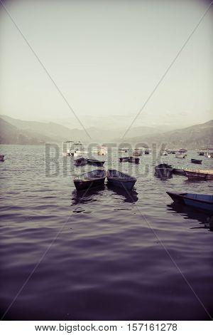 Colorful boats in Phewa Lake in Pokhara Nepal