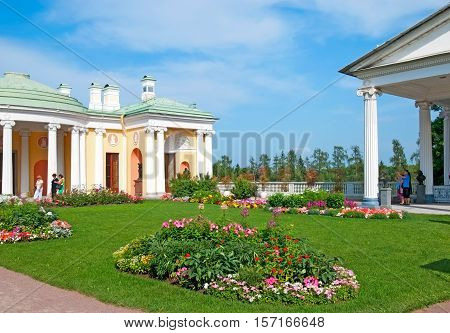 TSARSKOYE SELO, SAINT - PETERSBURG, RUSSIA - JULY 25, 2016: Tourists near Cold Bath Pavilion and Agate Rooms. Foreground is The Hanging Garden in The Catherine Park. Right side is The Cameron Gallery