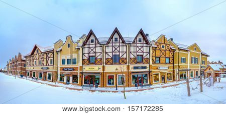 KIEV UKRAINE - NOVEMBER 11 2016: The stepped gable houses in Dutch Revival style shopping neighborhood occupied with the fashion boutiques and surrounded by snowy streets on November 11 in Kiev.