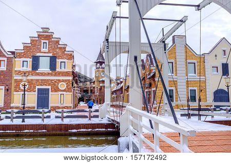 KIEV UKRAINE - NOVEMBER 11 2016: The Dutch style outlet city boasts the drawbridge that is the same copy of such bridge in Amsterdam on November 11 in Kiev.