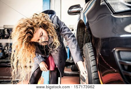 Woman and her car at the garage