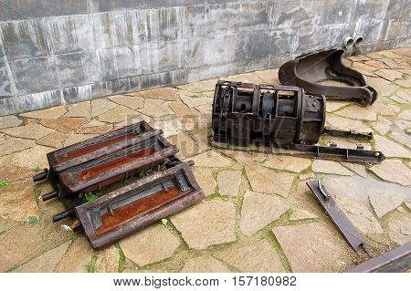Parts and mechanisms of the old mine and metallurgical equipment Nevyansky metallurgical plant breeders Demidov. Nevyansk, Sverdlovsk region, Russia,