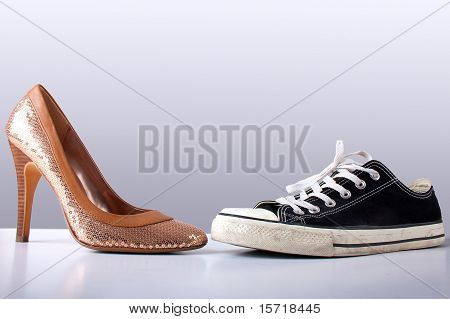 Fashion And Sport Shoes On Abstract Grey Backround
