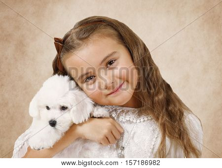 Portrait of a little girl with Bichon Frise puppy on a beige background