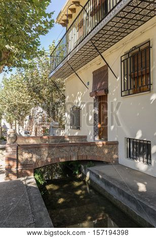 Waterway Typical street of the village and entrance to a house Anna Valencia Spain Canal de Navarres