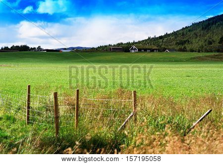 Norway farm field landscape with fence background hd