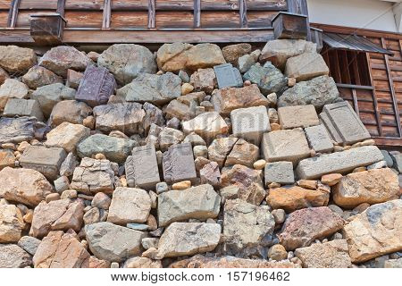 FUKUCHIYAMA JAPAN - JULY 29 2016: Gravestones were included into foundation of dojon of Fukuchiyama castle. Castle was erected in 1579 by Akechi Mitsuhide abandoned in 19th c reconstructed in 1985