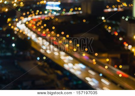 Blurred lights city highway curved night view, abstract background