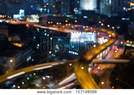 Night lights blurred bokeh highway intersection, abstract background
