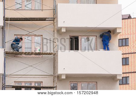 Anapa, Russia - November 16, 2016: The Workers Perform The Finishing And Painting The Facade Of High