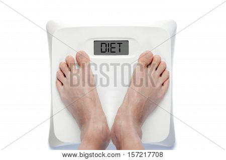 Feet On Bathroom Scale Isolated On White