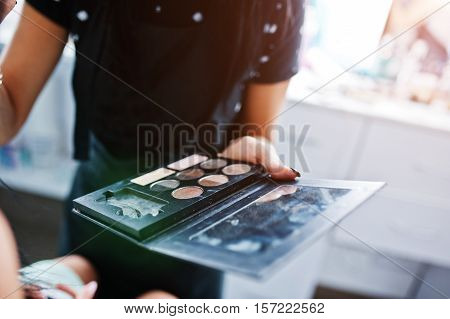 Colourfull Make Up Palette On Hand Of Makeup Master On Work  At Beauty Salon