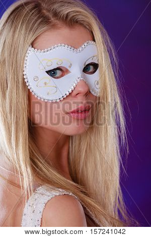 Holidays people and celebration concept. Closeup woman face caucasian blonde girl with white carnival mask