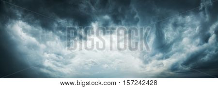 Dramatic Sky Background. Stormy Clouds in Dark Sky. Moody Cloudscape. Panoramic Image Can Be Used as Web Banner or Wide Site Header. Toned and Filtered Photo with Copy Space.