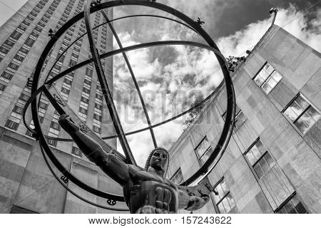 The Statue of Atlas in front of the Rockefeller Center in New York City in black and white