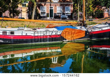 typical flat-bottomed boat at the Ijsselmeer in Enkhuizen, Netherlands