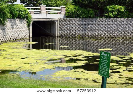 JOLIET, ILLINOIS / UNITED STATES - MAY 18, 2016: Trespassing, boating, swimming, ice skating, and snow mobiling are all prohibited on the Wesmere Country Club's private lake.