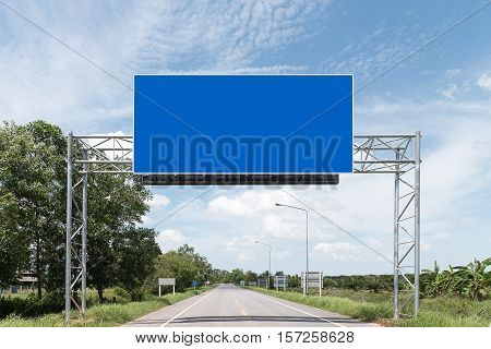 Blank Blue Road Sign - Pair of roadsigns in blue color on road and sky