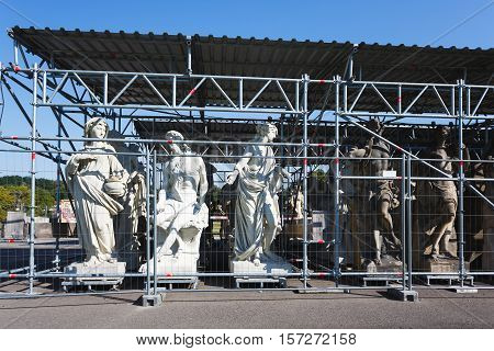 Potsdam Germany - August 27 2016: Statues under reconstruction nearby the New Palace of Sanssouci in summer time