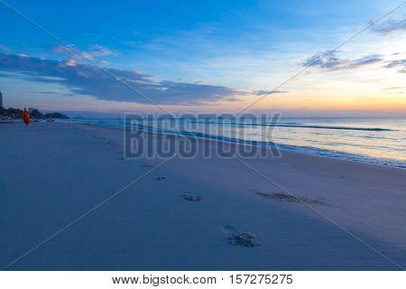 An impressive sunrise over the sea at Hua Hin beach Thailand.